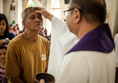 A priest places ashes on the head of an inmate during Ash Wednesday mass at the at the Ina ng Awa Parish, located inside the New Bilibid Prison Reservation in Muntinlupa City, March 1, 2017. JOHANN MANGUSSAD
