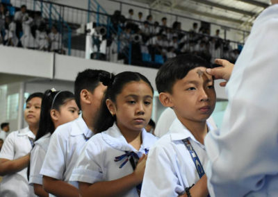 Students queue up to have crosses etched to their foreheads with ash by a priest at the Immaculate Heart of Mary College in Parañaque City, as the country marks Ash Wednesday. MICHAEL DALOGDOG