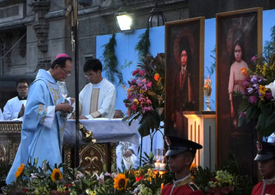 Novaliches Bishop Emeritus Teodoro Bacani incenses the images of Blessed Francisco and Jacinta Marto during a Mass at the UST in Manila, May 12, 2017. The two Fatima visionaries will be canonized by Pope Francis on May 13 the centenary of the Marian apparition, making them the youngest non-martyrs to ever be declared saints. ROY LAGARDE