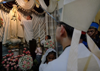 A priest crowns the image of Our Lady of Fatima as Cardinal Luis Antonio Tagle looks on during a Mass to mark the 100th anniversary of the Fatima apparitions and the Silver Jubilee of Our Lady of Fatima Parish in Pasay City, May 13, 2017. ROY LAGARDE