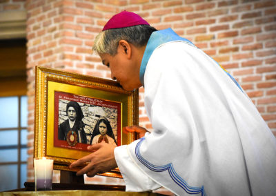 Lingayen-Dagupan Archbishop Socrates Villegas, CBCP President, kisses an image of Saints Jacinta and Francisco Marto, two of the visionaries of Our Lady of Fatima, during a Mass Dagupan Cathedral, May 13, 2017. GLENN MUNOZ LOPEZ