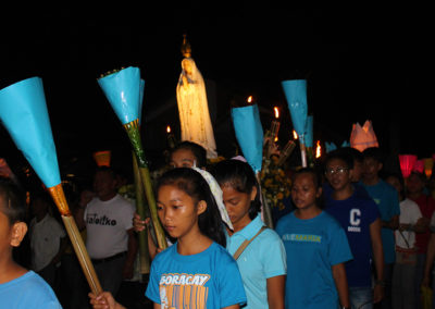 Devotees join a procession to mark the 100th anniversary of the Fatima apparitions in Taft, Eastern Samar, May 12, 2017. EDMEL RAAGAS