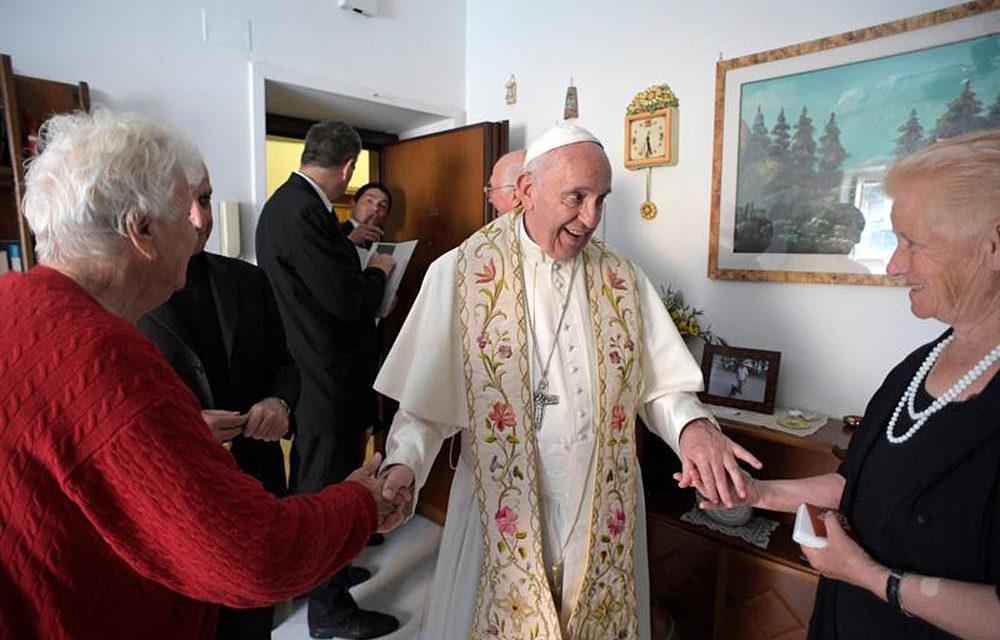 Pope goes door to door, blessing the homes of the poor