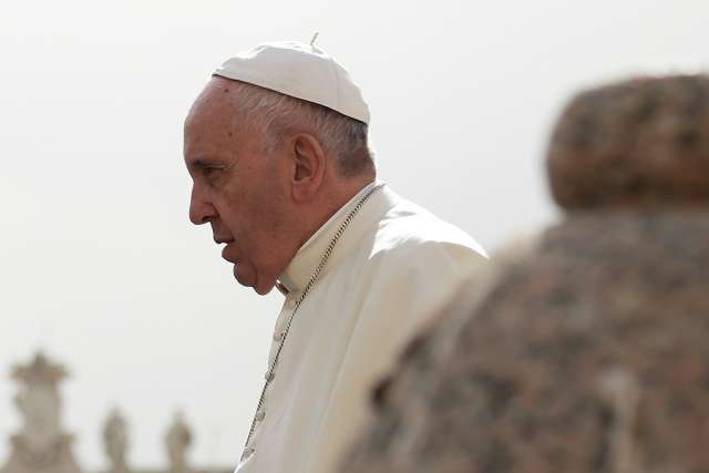 In book foreword, Pope Francis calls corruption a 'cancer'