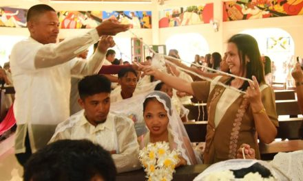 22 couples tie the knot amid bombings