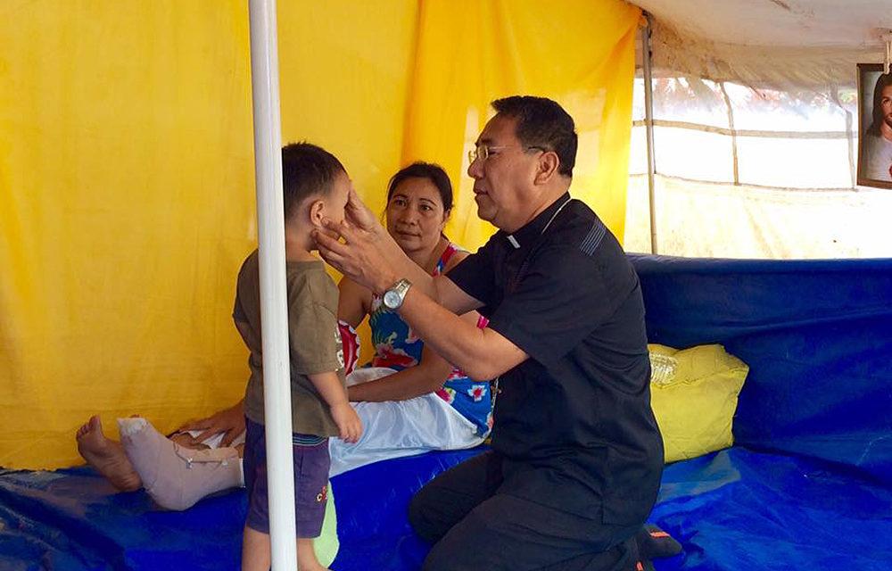 Palo archbishop visits quake victims