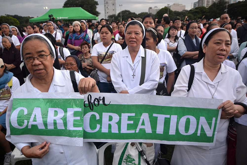 Nuns attend the Mass to celebrate the World Day of Prayer for the Care of Creation at the Luneta Park in Manila, September 1, 2017. ROY LAGARDE