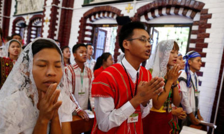 Pope, as 'grandfather,' urges Myanmar's young to love and serve