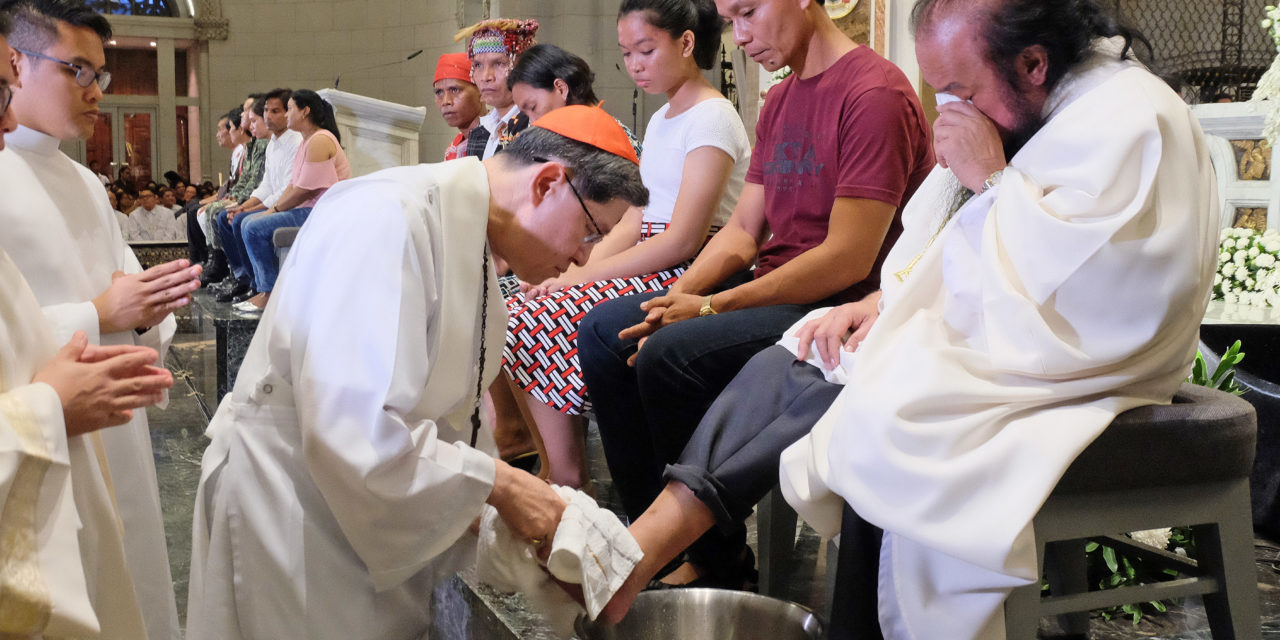 Cardinal Tagle washes feet of abducted priest