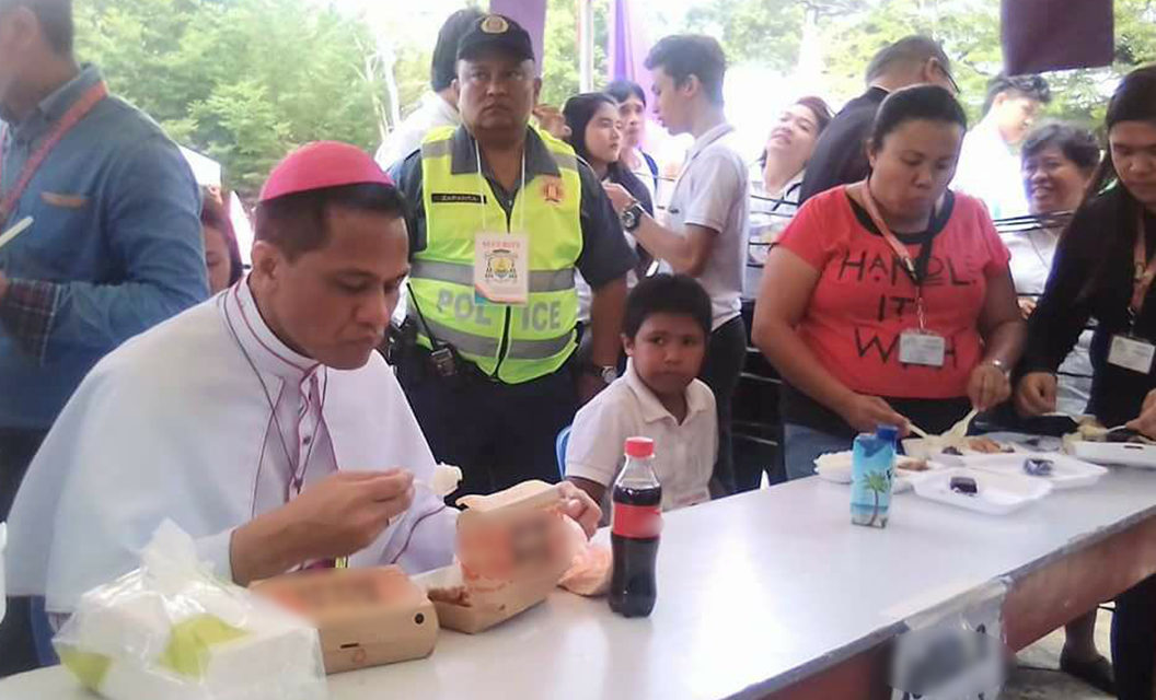 New bishop Dael dines with poor after ordination