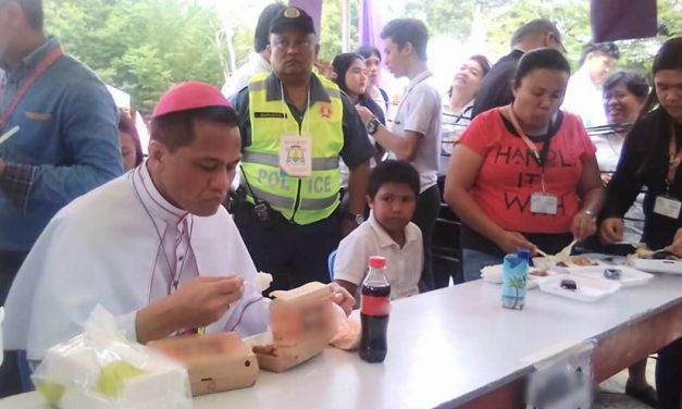 New bishop Dael dines with poor after ordination