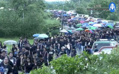 Sea of black as thousands flock to slain priest's funeral