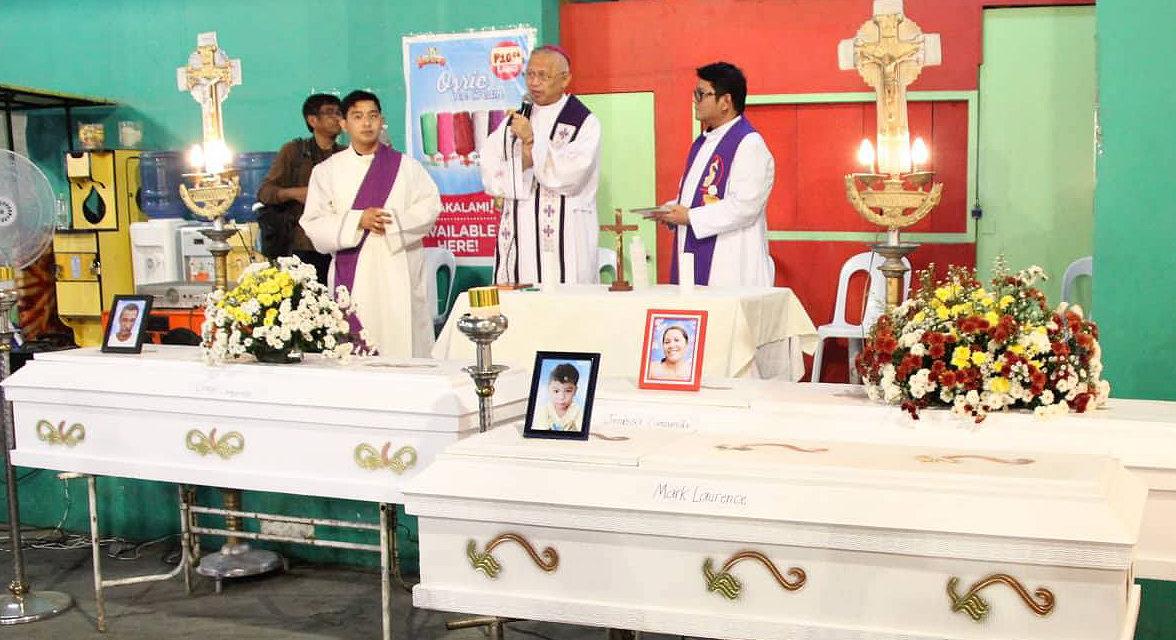 Archbishop Palma visits landslide victims in Naga