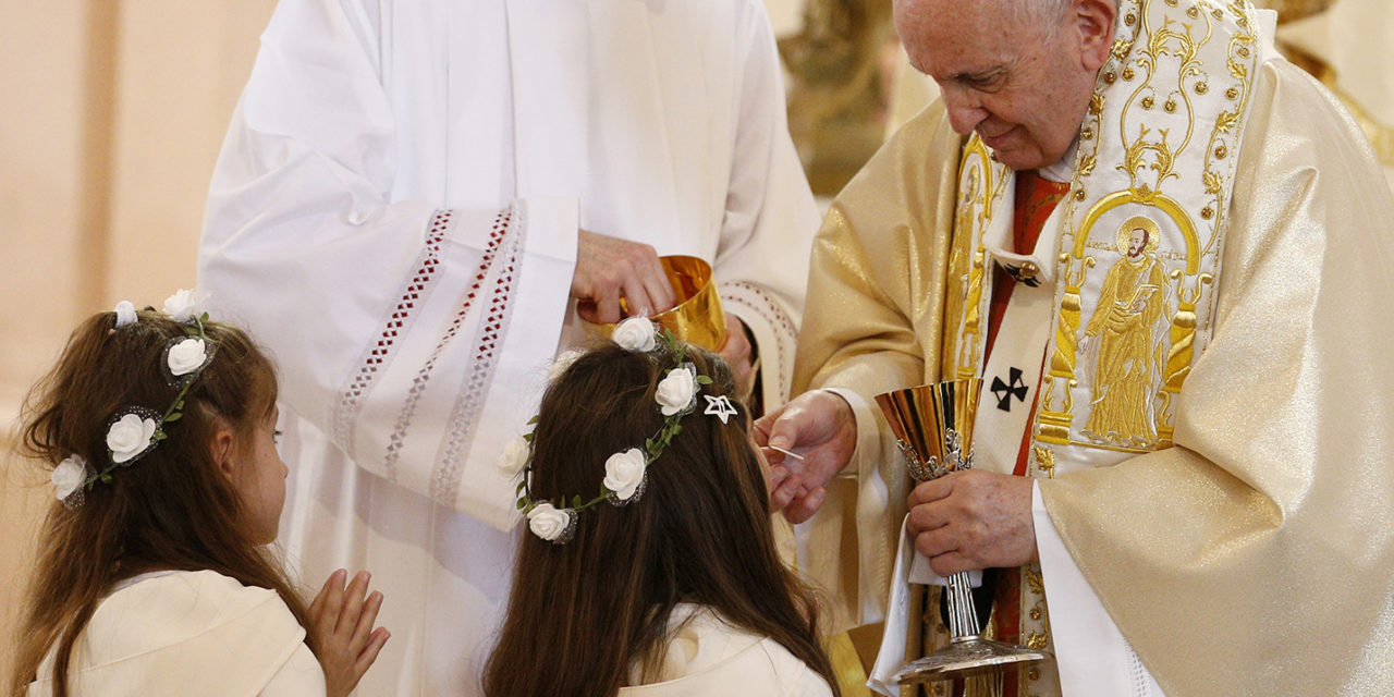 After offering instruction, pope gives first Communion to 245 children
