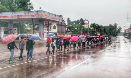 Young pilgrims brave heavy rains to honor St. Clare