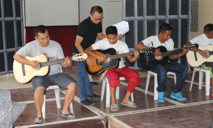 Inmates rediscover joy, faith through guitar lessons
