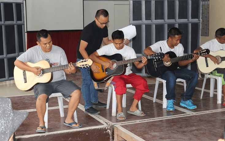 Inmates rediscover joy, faith through guitar lessons
