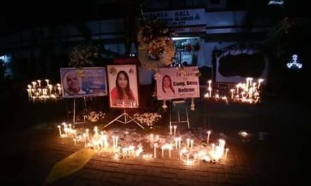 Parish holds candle-lighting for slain barangay chair