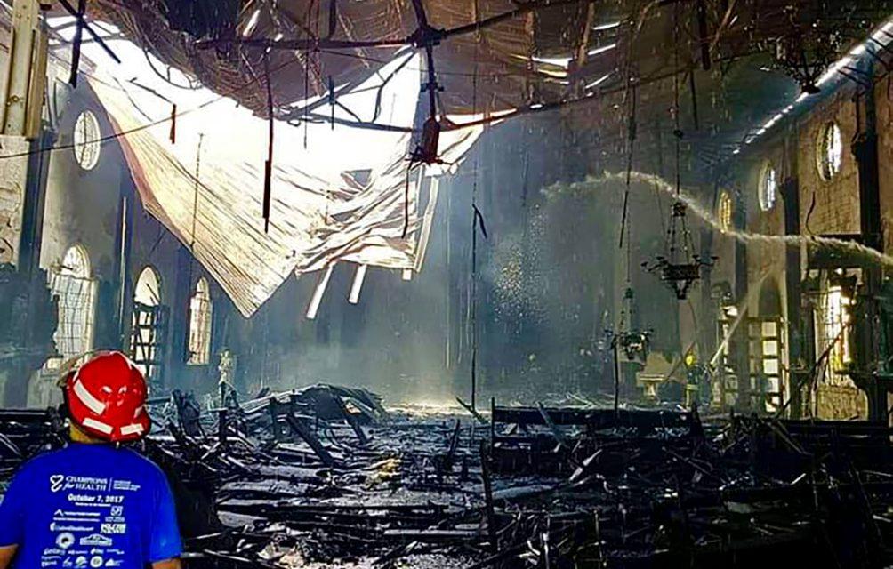 Bishop asks prayer after fire destroys Sto. Niño Church in Manila